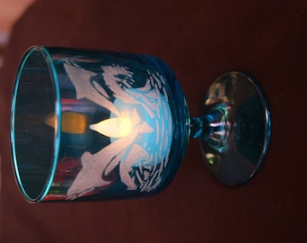 Candle holder with a blue glass