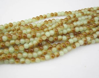 40 khaki and brown glass pearls