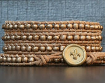 pale gold wrap bracelet - seed beads on natural leather - fleur de lis button - modern casual boho jewelry - simple bracelet
