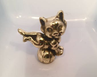 Clever Cat jumping a ball in brass by CustomMadeCastings