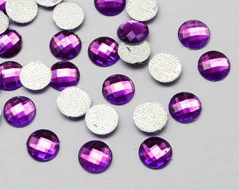 A faceted purple rhinestones 100