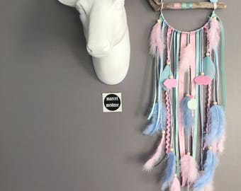 Dream catcher drift wood, powder pink color, mint and blue sky with clouds