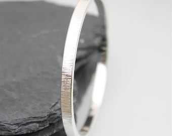 Handcrafted Sterling Silver Bangle with Hammered texture solid, thick with a contemporary finish.