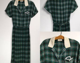 Vintage 1960s green plaid silky day dress with drop waist and pleated skirt