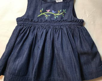 One of a kind baby jean dress, one size only 0-3 months on dress with handpainted flowers