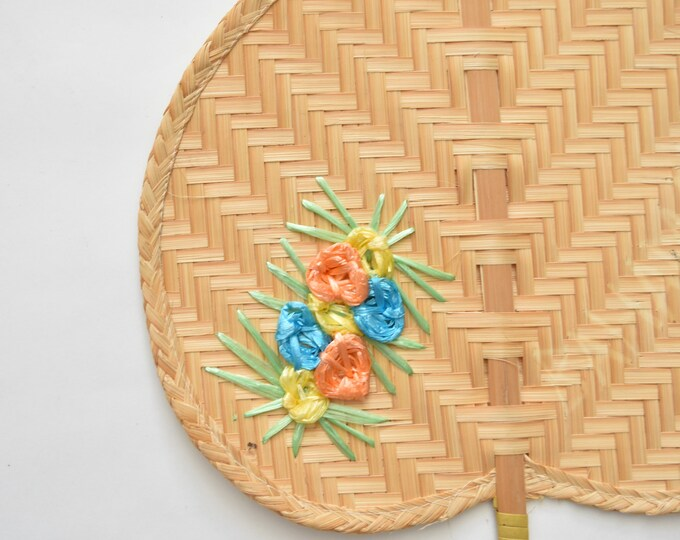 embroidered delicate woven rattan fan / wall basket