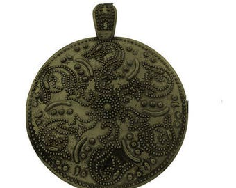 Very large pendant round bronze worked flower pattern
