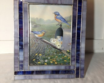 Handcrafted stained glass picture frame.