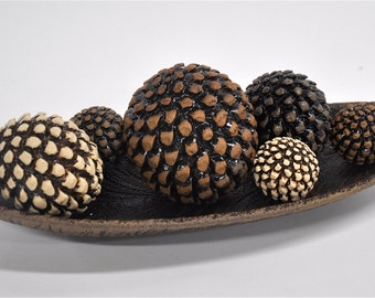 Bowl of pinecone rattles