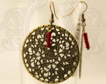 Bronze filigree earrings and Red bead.
