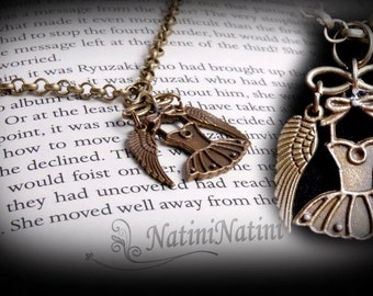 Winged dress necklace