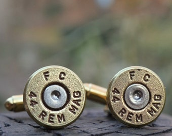 Bullet cufflinks fashioned from repurposed gold/brass Federal .44 magnum shell casings