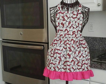 Hello Kitty apron with a cute with or without ruffle, can be made in xsmall, small, medium, large and xlarge.