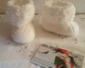 White wool knitted baby booties in size newborn and 3 months