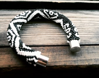 The bracelet of beads is crocheted.