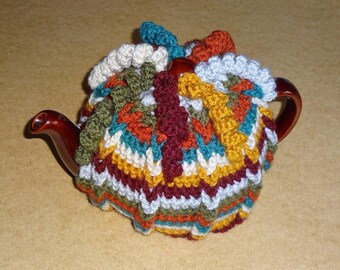 Multi-coloured hand crocheted tea cosy to fit 6 cup teapot