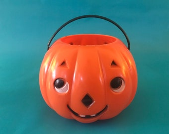 1950s Shy Double Faced Plastic Jack O Lantern with Plastic Handle