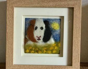Guinea Pig 2d needle felt picture. Cheeky Guinea Pig in Buttercups enjoying the sun. Made from sheeps wool and other fibres