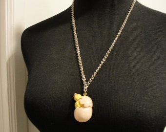 chicken hatching from egg vintage pendant used condition composite