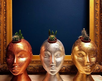 Upcycled polystyrene female head planters with three cactus