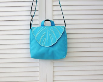 blue  monstera leaf Crossbody Bag