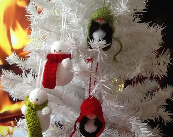 Knitted Christmas Decorations. Traditional Snowmen and Sweet Baby Penguins.