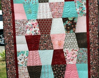 Blush Tumbler Throw Quilt