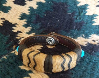 Upcycled leather cuff with turquoise rivets and rawhide slides