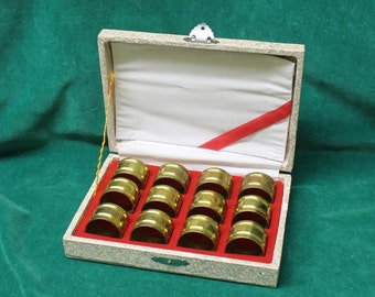 Vintage Boxed Twelve 12 BRASS NAPKIN RINGS table setting hostess gift wedding present original hinged box w/ clasp