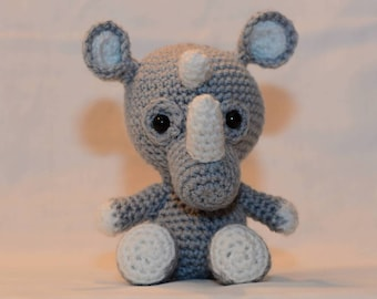A handsome little rhino. Hand crocheted little rhino, a plush softie animal. Tiny Zoo Rufus the Rhino