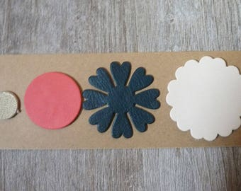 set of 4 fine leather, round and flower cutouts