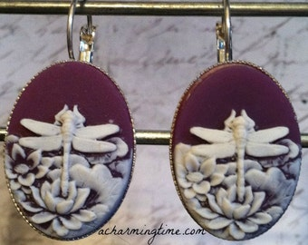 Earrings with a White Dragonfly on a Purple Colored Cameo on Lever Back Hooks