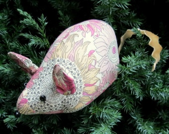 Mouse pin cushion.  A pin cushion made from a floral Liberty Lawn.