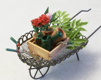 Mini wheel barrel stuffed with potted flowers and garden tools: Fairy or gnome Garden miniature terrariums