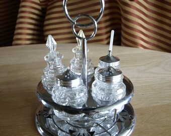Vintage Stainless Steel Metal and Glass Condiment Carousel Caddy with Shakers, Cruets and Dips