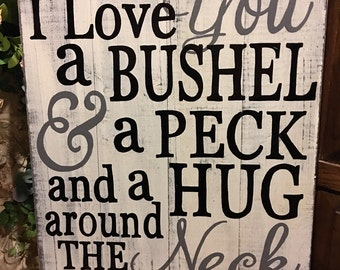 Bushel, Peck and hug around the neck Hand painted sign repurposed palet board sign