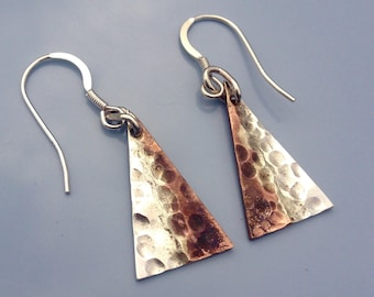Handmade recycled bronze and sterling silver triangle earrings.