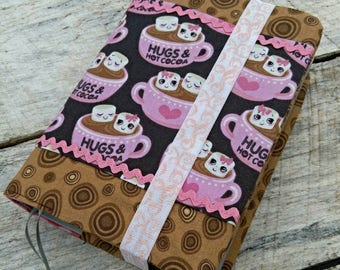 NWT Cute prints reversible fabric Bible cover, Hot cocoa and polka dots, standard sized. Pink polka dot on reverse. Hot chocolate, winter.