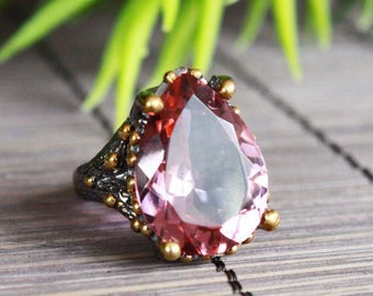 Sterling silver 925 oxidized and gold plated statement ring with pink quartz crystal