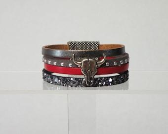 Buffalo head, red leather bracelet