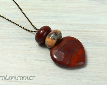 Red heart pendant necklace from jasper .