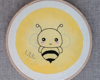 Embroidery small bee on yellow watercolor background