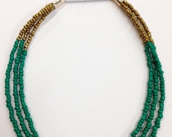 Gold & green multi-strand necklace and earrings.
