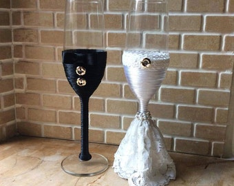 Bride and groom wedding toasting champagne flutes