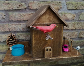Nest box for birds with drinking trough