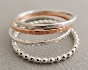 1 Rose Gold Ring - 3 Sterling Silver Rings - 4 thin mixed stacking rings
