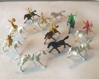 Vintage lot of 11 miniature horses and 7 cowboys or indians that ride them.