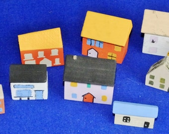 Set of ten little wooden houses for children to play with or model making scenery