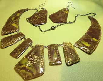 Beautiful breastplate with bronze earrings with polymer clay