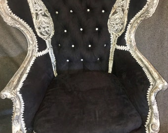 Richly carved,music room wingback chair from around 1940's! newly upholstered with a beautiful distressed paint look lovely statement piece